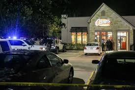 officer kills robber at raising cane u0027s restaurant houston chronicle