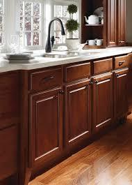 braddock alder clove kitchen by thomasville cabinetry featuring