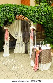 wedding arch grapevine outdoor wedding arch with table grapevine stock photo