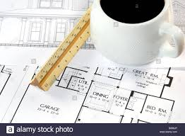 home design drawings and a coffee on an architects desk stock