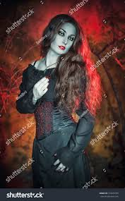 beautiful halloween background beautiful witch long hair on halloween stock photo 319465796