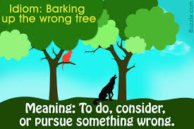 the meaning and origin of the idiom barking up the tree