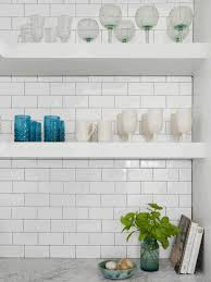 kitchen hanging shelves brown brick wall tile white wooden cabinet