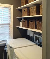Laundry Room Storage Shelves by Laundry Room With Mounted Shelves And Wicker Baskets Good
