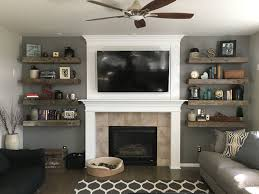 rustic living room barnwood floating shelves shiplap fireplace