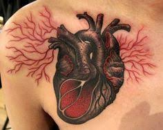 matching anatomical heart tattoos done at freaks and geeks tattoo