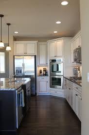 quartz countertops white kitchen cabinets with dark floors