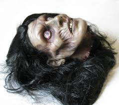 female zombie cut off human head scary halloween haunted house