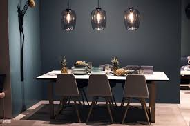 corner dining area gray dining chairs pineapple monocromatic