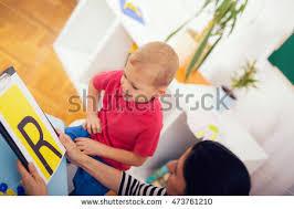 speech therapist teaches boys say letter stock photo 501262060