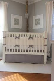a creamy ivory and light gray crib bedding set in a masculine
