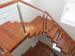 modern wood stairs with a stainless steel cable railing system