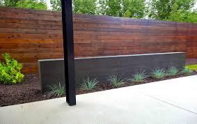 wood siding in modern steel arbor and poured concrete water
