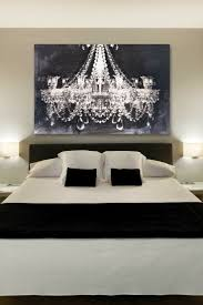 Modern White And Black Bedroom The Chandelier Art Gives Such A Romantic Touch To This Bedroom