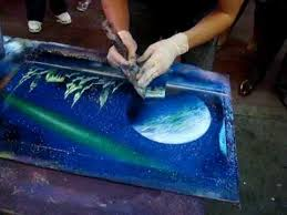 Amazing Spray Paint - creative pool artwork painted using a skateboard and a spray can