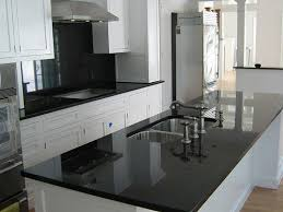painted black glass backsplash with white cabinets black and