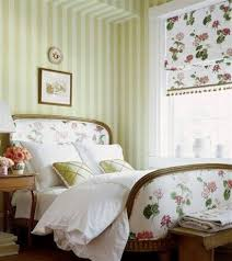 country style bedroom with floral blinds and bed frame and striped