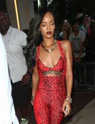 rihanna jumpsuit rihanna to sue topshop flaunts slim figure in print jumpsuit