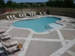pool deck surface material comparison the concrete network