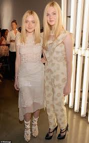 what is dakota fanning doing now new york fashion week 2011 elle fanning 13 towers over sister