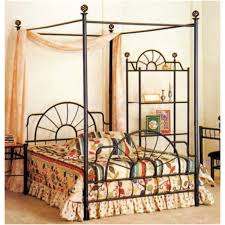 classic black polished iron full size canopy bed with cream sheer