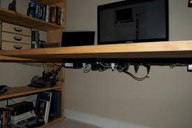 how to organize cables under desk diy nomad bookshelf desk diy projects for everyone
