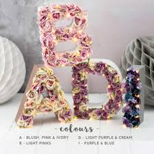 light up flower initials cake topper by the white bulb