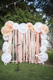 diy photo booth wedding wedding booth decorations diy paper wedding backdrops brit co