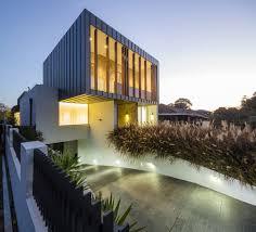 exterior modern house design with ground garage design and stone