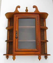 single glass door cabinet agreeable kitchen wall mounted curio cabinet come with brown