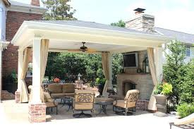 covered patio with fireplace patio ideas outdoor patio with fireplace and tv image gallery of