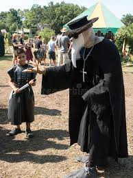 plague doctor costume a in plague doctor costume and a boy at renaissance festival
