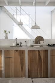 a gorgeous kitchen concrete walls living