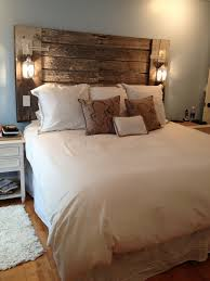 The headboard my husband made me out of reclaimed barn lumber and
