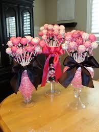 cake pops or lollipops in jars are stuck in styrofoam balls the