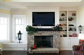 television over fireplace should i install my tv over my fireplace a little design help