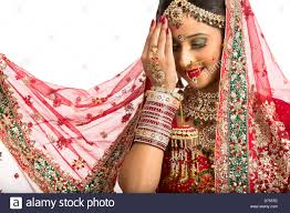 traditional dress up of indian weddings smiling indian in traditional wedding dress stock photo