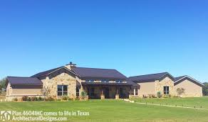 house plan 46041hc comes to life in texas with a 4 car garage