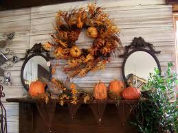 lovely fireplace mantel using pumkins also mirrors wall