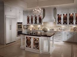 Classic White Kitchen Cabinets White Kitchen Decor Ideas With Chandeliers And Black Countertop