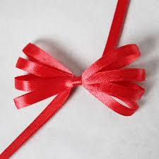 gift wrapping bows how to make a ribbon bow for gift wrapping using a comb