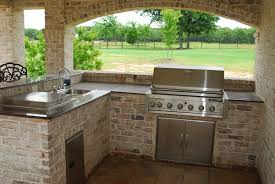 european style outdoor patio kitchen design with rustic brick f european style outdoor patio kitchen design with rustic brick f walls small l shaped cabinets including aluminum stove and single