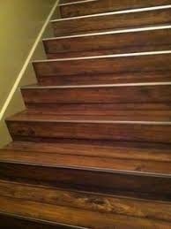 image result for lvt plank flooring transition to wood stairs