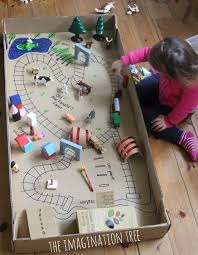 cardboard tunnels cereal box train station and train tracks drawn