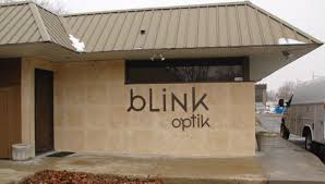 blink optic building sign with cut out aluminum letters painted