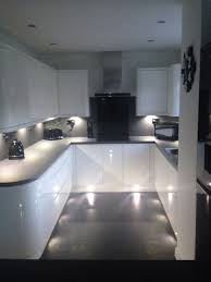 gloss kitchen ideas white gloss handless wren kitchen with grey slate work top