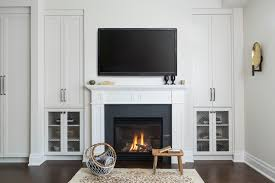 where to place tv in living room with fireplace tv over fireplace design ideas