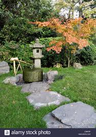 japanese ornamental water feature and lantern situated in the