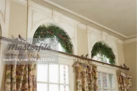 How To Hang Curtains On A Round Top Window Window Treatments Palladian Windows Above Pastoral Printed
