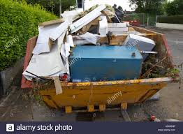 uk waste stock photos uk waste stock images alamy builders skip full of household rubbish and waste due to home improvements sitting on roadside newtownabbey